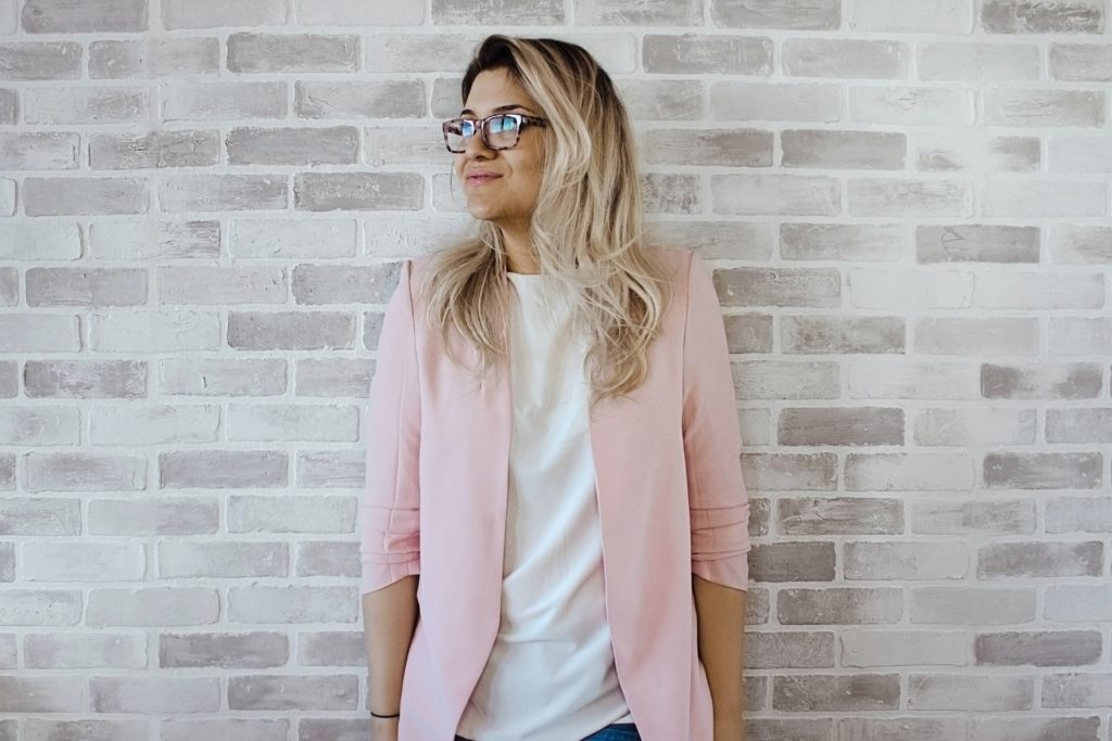 Woman In Pink Cardigan And White Shirt Leaning On The Wall 975657
