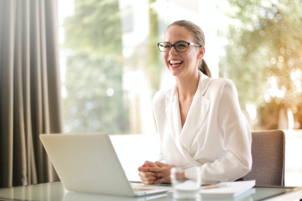 Laughing Businesswoman Working In Office With Laptop 3756679 Min