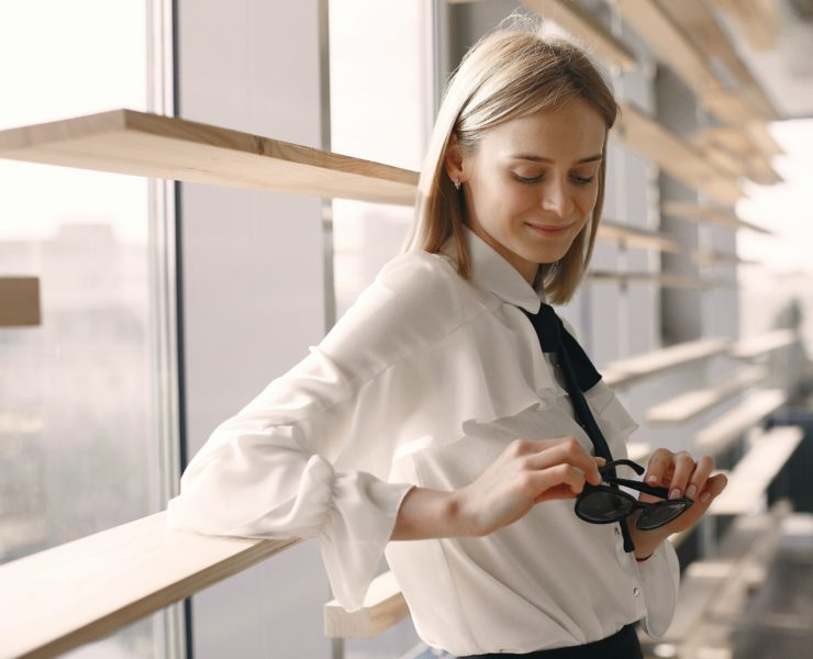 Positive Woman Holding Sunglasses In Office 4173257 Min