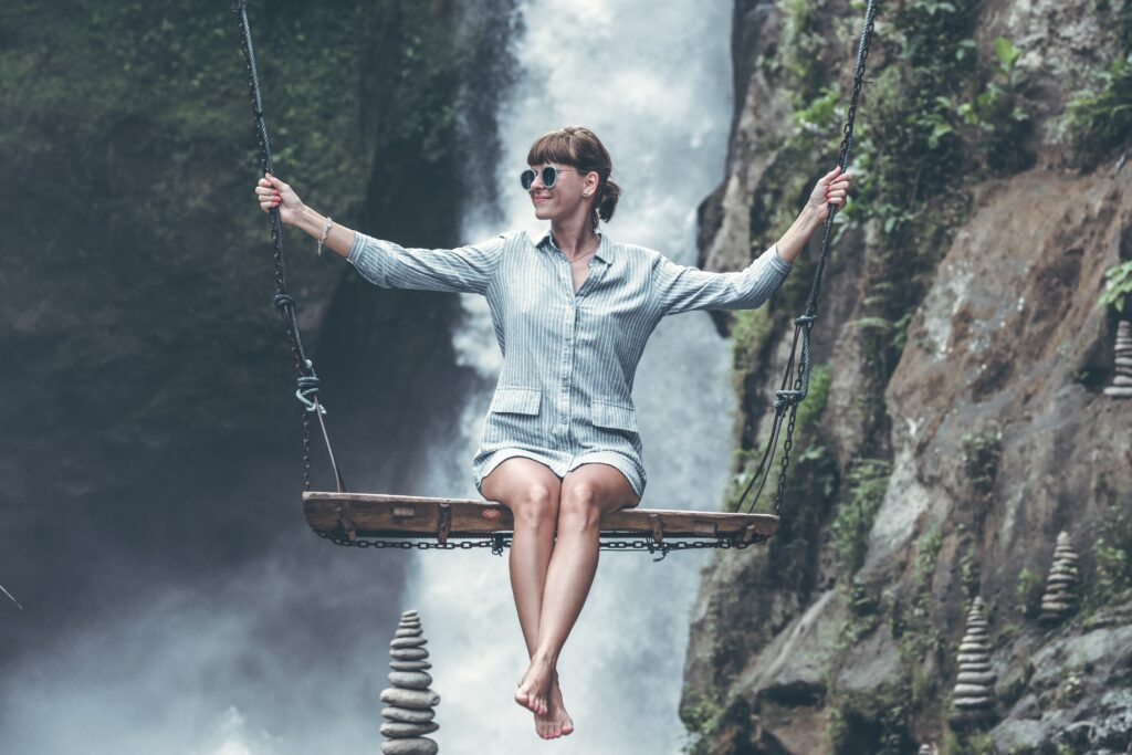 Photo Of Woman Riding Swing In Front Of Waterfalls 1160131