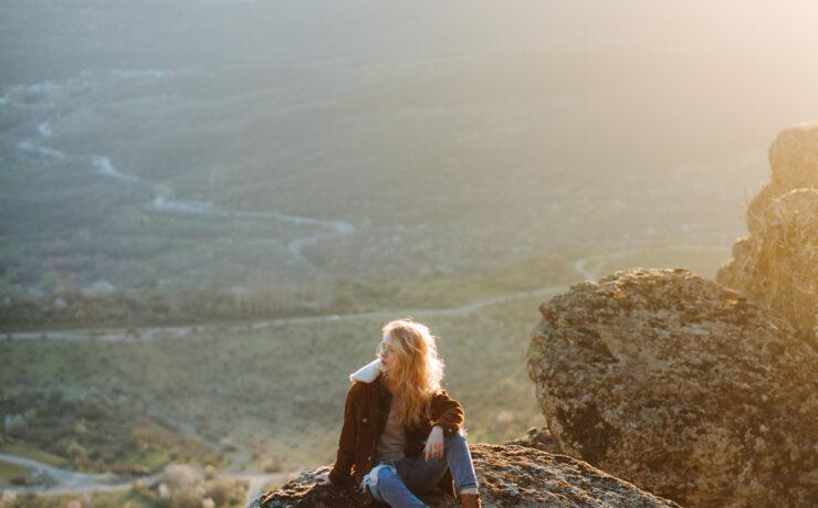 Photo Of Woman Sitting On Rock 4510709